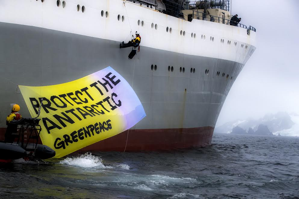 "Greenpeace activists in peaceful protest, displaying a banner saying ""Protect the Antarctic"" on the Ukrainian krill trawler 'More Sodruzhestva' in the Bransfield Strait near Greenwich Island, Antarctic.  Greenpeace is calling for the krill industry to commit to stop fishing in any area being considered by governments for ocean sanctuary status, and to back proposals for marine protection in the Antarctic."