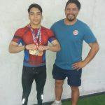 Daniel Bravo junto a su entrenador Alfredo Lazo.